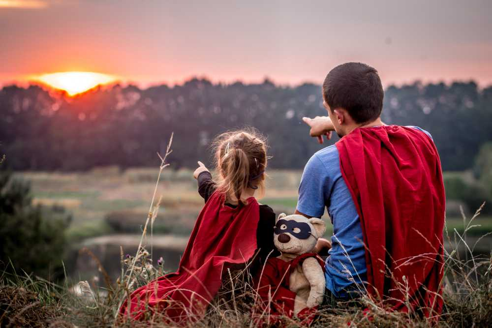 highcompress little girl with dad dressed super heroes happy loving family